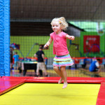 Girl playing on trampoline at Rockin' Jump in Santa Ana